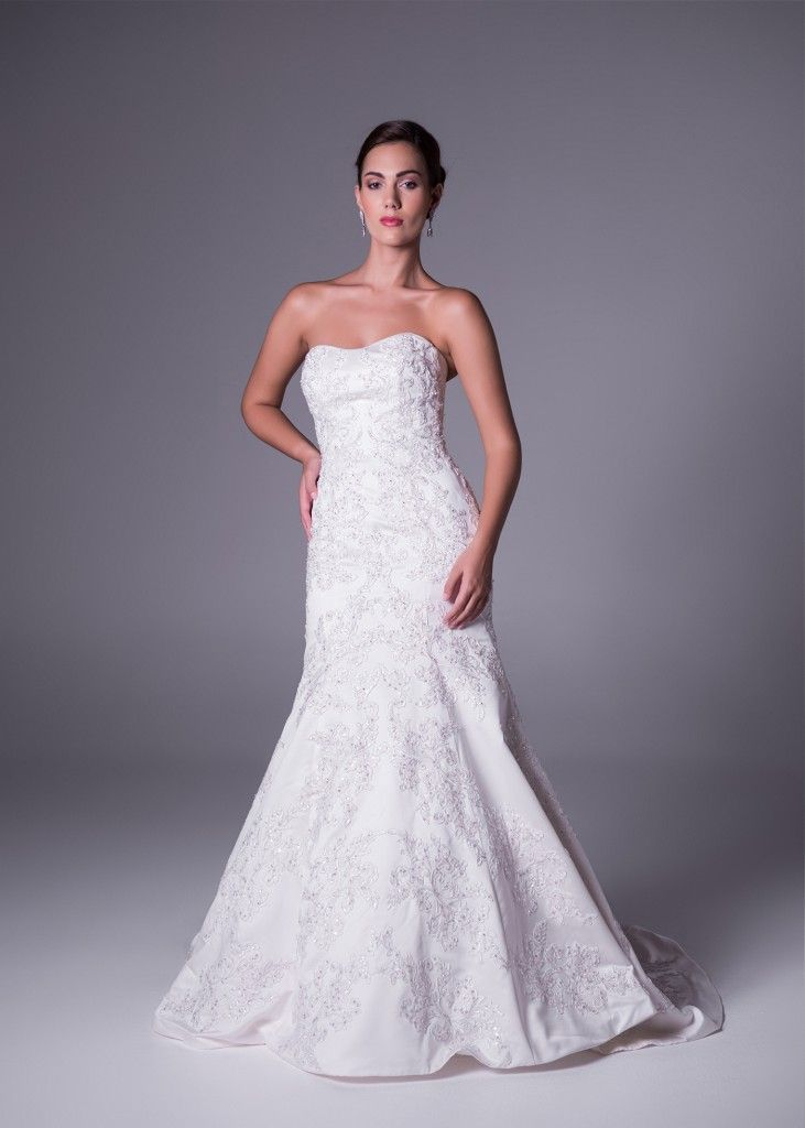 WOW! This strapless satin fitted bodice wedding gown with stunning lace overlay (style CWG594). Get it exclusively from Bride&co's Oleg Cassini range. Click to book a fitting in this dress!   #strapless #weddingdress #weddinggown #satin #lace #olegcassini #brideandco #southafrica