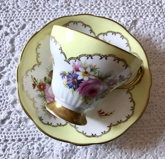 Vintage E.B Foley china tea cup and saucer, made in England. An absolutely stunning set, yellow and white with lovely hand painted pink, purple white and yellow flowers. It is in good condition, no chips, cracks, crazing or repairs. Both pieces ring nicely Please Note: The