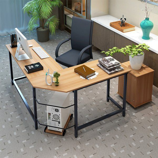 This modern L-Shaped Computer Desk for home office is sturdy and big. This simple design L-shaped desk includes one rectangular desktop, one diagonal cut desktop, and steel metal legs, which all join together in an L-shape for abundant surface space and compact placement in a room's corner.