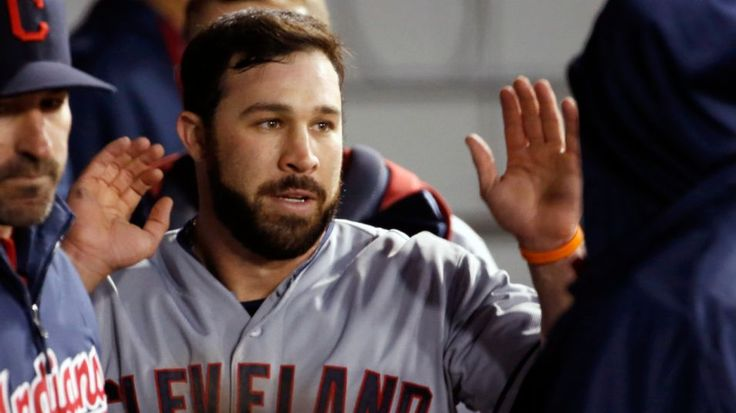 Cleveland Indians' Jason Kipnis is greeted in the dugout after scoring on a double by Jose Ramirez, during the sixth inning of a baseball game against the Chicago White Sox Tuesday, May 19, 2015, in Chicago. (AP Photo/Charles Rex Arbogast)