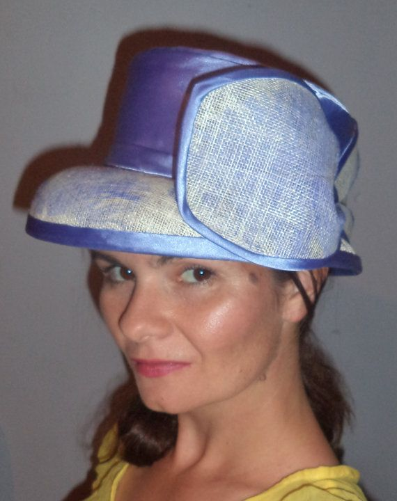 Blue and white hat with feather details. by MillinerybyMelissa
