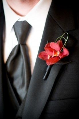 simple red orchid boutonniere