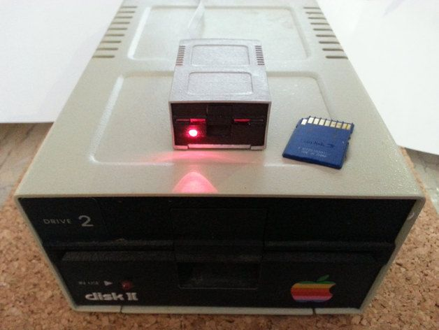 Case for generic SD Card reader in the form of the Apple II disk drive, Disk ][.   Complete, assembled and painted pieces are available at https://www.etsy.com/shop/RetroConnector or  https://www.shapeways.com/product/R4S2W3BNS/apple-disk-ii-1-4-scale-shell https://www.shapeways.com/product/UNPHY8H2U/apple-disk-ii-1-4-scale-interior Updated 12/2015 with new version. Now the base and support structure for the internals ...