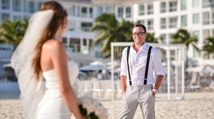 We love this groom's suspenders! Perfect outfit for a beach wedding. | Palace Resorts Weddings ® #destinationwedding