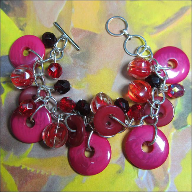 Big Bling Bracelet has Fun Chunky Design with Bold Red Beads and Fashion Buttons