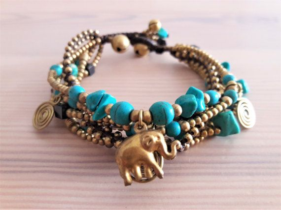 Welcome to Bohemian Style Thai Elephant Collection!  Youre looking at a one-of-a-kind, 5-strand turquoise bracelet with elephant charm. Each line is a different design of turquoise coral, turquoise howlite stones, featuring gold brass beads and adornments.   www.bohemianstyleshop.etsy.com