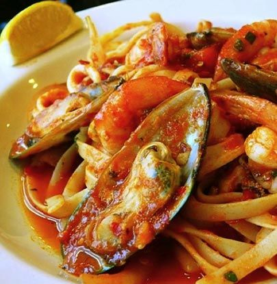 Seafood Marinara This dish is loaded with mussels, shrimp, and calamari simmered in a chunky, buttery tomato sauce