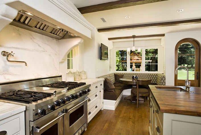 Love just about everything about this: the marble backsplash, the stainless steel, and the butcher block island
