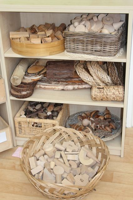 Building materials. Here you have a great combination of natural wood blocks and loose parts from the environment with just the right amount of variety and quantity so as not to overwhelm and still encourage sharing and collaboration without limiting creativity and innovation.