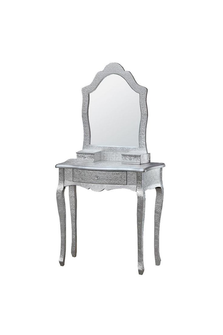 A dressing table complete with a mirror from our Chaandhi Kar collection is perfect for any bedroom, dressing room or salon. Featuring tall elegant cabriole style legs, three handy drawers with delicate crystal handles, a beautifully shaped mirror and a flat back which will sit flush against a wall. This piece is made from solid wood and covered with silver embossed aluminium panels for a unique and eye-catching finish.Inspired by classic Middle Eastern and Indian designs Each piece is…