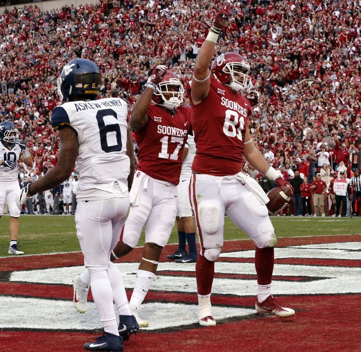 Oklahoma's Mark Andrews (81) scores during a college football game between the University of Oklahoma Sooners (OU) and the West Virginia Mountaineers at Gaylord Family-Oklahoma Memorial Stadium in Norman, Okla., on Saturday, Nov. 25, 2017. Photo by Steve Sisney, The Oklahoman