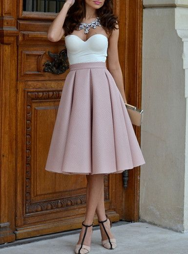 The top portion of this pink pleated skirt is high waisted. It can be with a sweetheart bodice and a built in bra which gives your bust line additional support and great shape. The top is white, which
