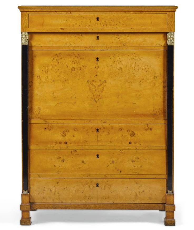 Northern Europe, Secrétaire à abattant,marble top above two frieze drawers, above a fall-front enclosing a fitted interior with eight drawers and central mirrored cupboard door, above three drawers gilt-bronze mounted and ebonised Karelian birch 161cm. high, 116cm. wide, 50.5cm. 19th century style