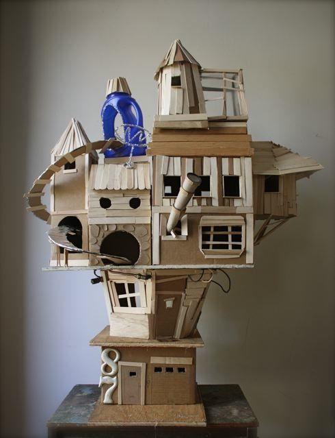 "Playhouse by Ann Wood: ""It's made of cardboard boxes, bits of found wood, foil, plastic and lots and lots of popsicle sticks"""