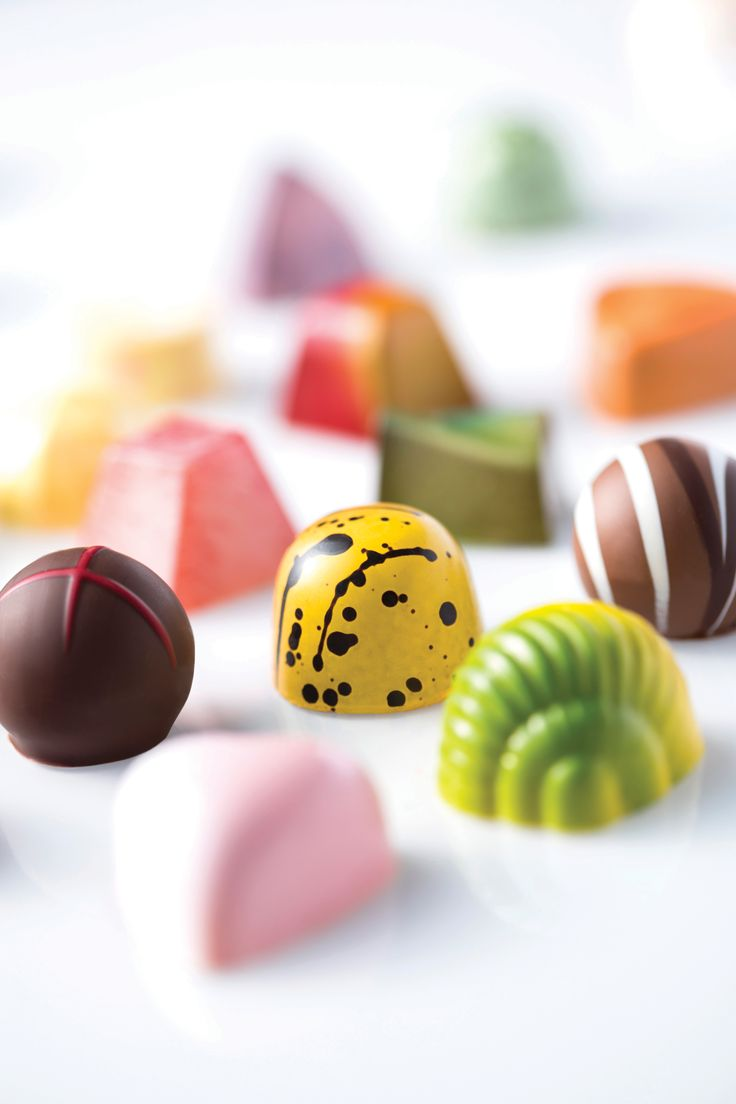"""""""Chocolate is my passion,"""" says Norman Love, who dreamed of making chocolate that was visually stunning as well as delicious. Love and a partner perfected a technique in which the colored designs for each candy are hand-painted or airbrushed into chocolate molds, which are then filled with the finest chocolate imported from Belgium, France, and Switzerland. The pumpkin white chocolate bonbon is almost too gorgeous to eat."""