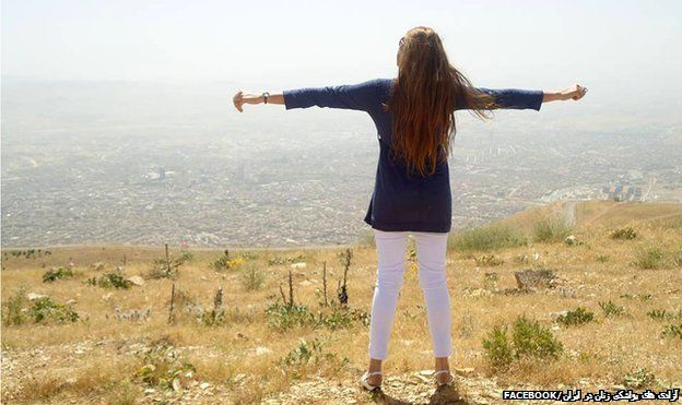 """The women in Iran taking off the hijab  A woman standing on the top of a hill with her back to the camera and her arms outstretched - one of the images of the """"My Stealthy Freedom""""..."""