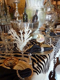 I love the cow hide look alike zebra rug on the table.... all the items could be used in many ways in many rooms for Staging.....