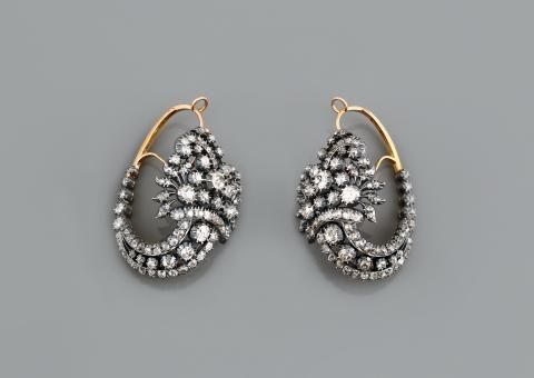 A gold, silver and diamond pair of earrings (J-699). Portugal, 18th Century. 34.9 g, diamond weight aprox: 15.60ct. Size: 5.5cm Exhibitor: J. Baptista Lda - The Art & Antiques Fair, Olympia.