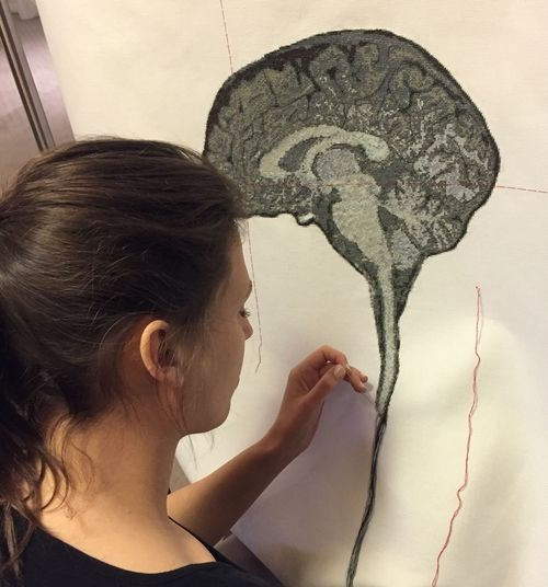 Artist Lada Dedic adding the brain stem to her Self Portrait Artists Brain