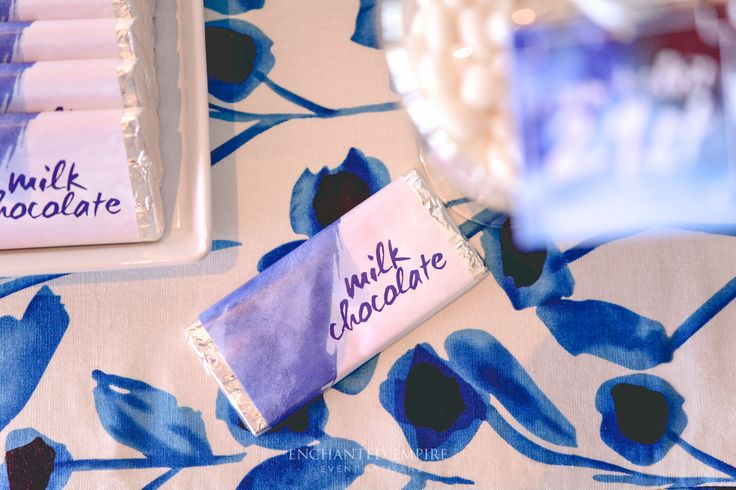 In hues of blue and elements of white, this candy bar was styled for our twin clients 21st Birthday celebration, with an emphasis on being neither masculine or overly feminine, to match each twins style. This artistic candy bar was inspired by the custom made watercoloured floral print cloth, matching watercoloured custom chocolate wraps and mini candy jar accents. A sweet treat for all guests at this milestone birthday.   http://www.enchantedempire.com.au/artistic-watercolour-21st-birthday/