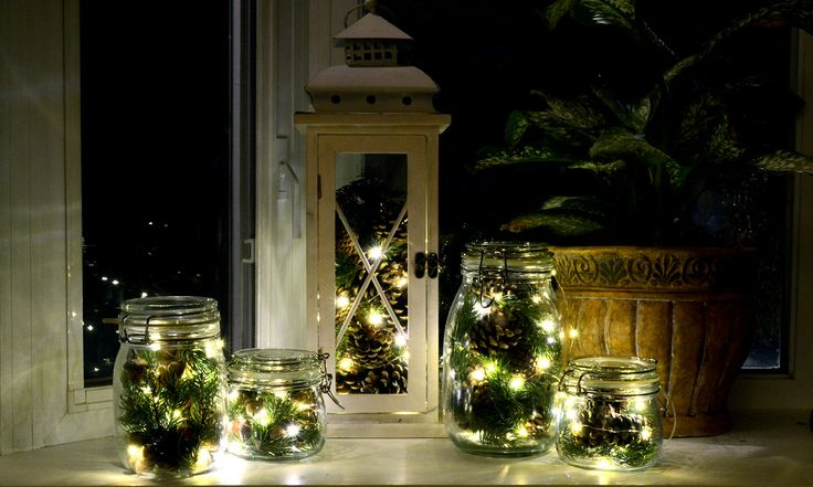 Want a simple and beautiful way to decorate for the Holidays? Try Holiday Twinkle Lights in Jars with fresh pine cones, acorns and evergreen clippings.