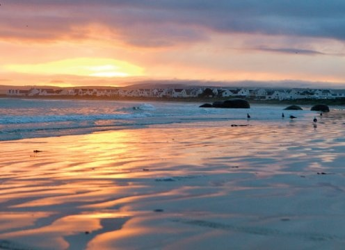 In the village of Paternoster, fishermen in frayed woollen jerseys rub shoulders with holidaymakers on the edge of one of the West Coast's prettiest bays. Photo: Sam Reinders