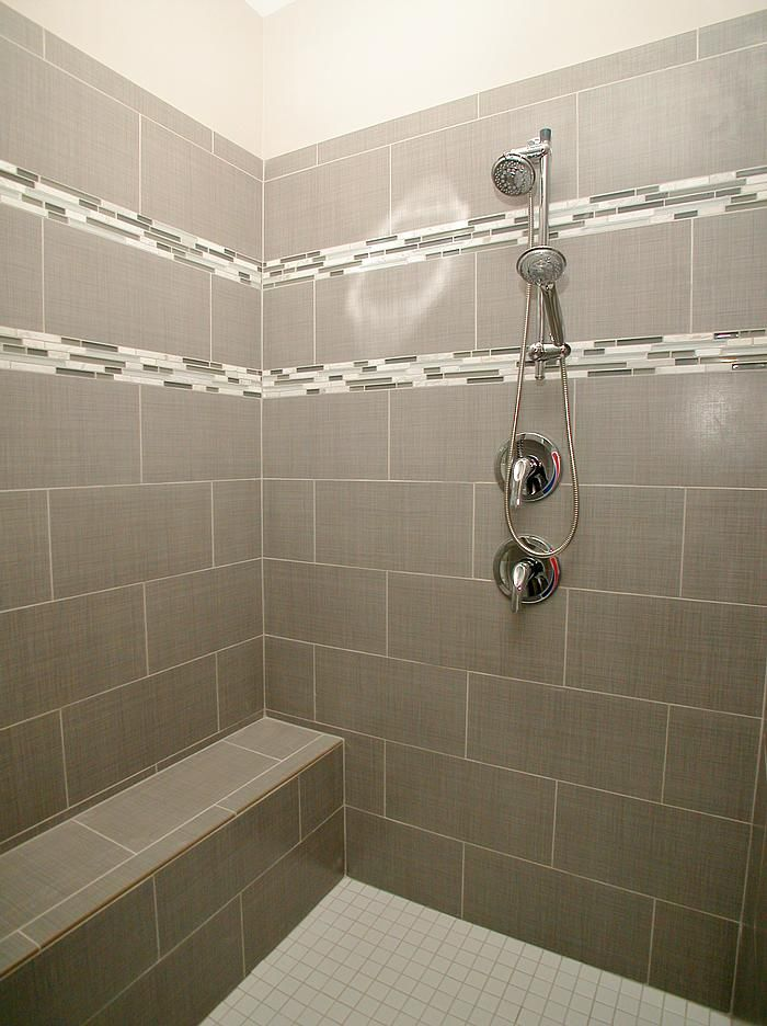 This Oversized Shower Features Linen Pearl 10x20 Brick Laid Wall Tile And White 2x2 Floor Tile