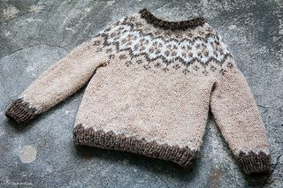 A Lopi sweater for toddlers with a traditional Icelandic yoke pattern.
