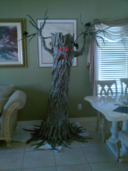 Haunted tree--make a base around a thrift-store floor lamp and use twisted brown paper and wire for the details? Red Saran Wrap or paper for the eyes...