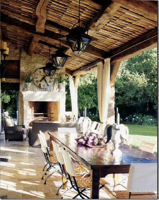 rustic ceiling, lanterns but elegant as well. love the fireplace with the old clock