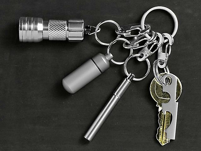 A true pocket essential, the Everyday Carry Keychain boasts a metal ink pen, a micro LED flashlight, a capsule to stash away small items or cash and a 7-in-1 multifunction tool. GetdatGadget.com/everyday-carry-keychain/