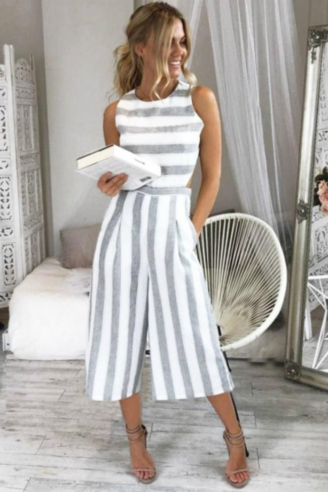 See Ya There Striped Jumpsuit: You and the See Ya There Striped Jumpsuit go together like tan lines and sunshine! A classic gray and white stripped print features side and back cut-outs, and a modest neck line. TheChicFind.com