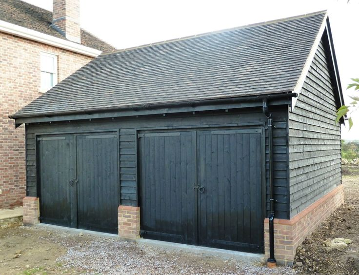 Black clad garage with tile roof google search barn 1 for Weatherboard garage designs