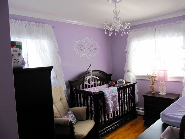 Love the purple, ruffle curtains and chandelier.  Would work well with our black crib for baby girl's room.