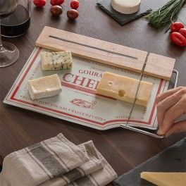 Slicing cheese has never been as safe and easy as now thanks to the kitchen board with cheese slicer! Its modern and functional design makes slicing easy and improves the presentation.  Made of wood and glass Stainless steel side slicer Approx. dimensions: 30 x 24 x 2 cm