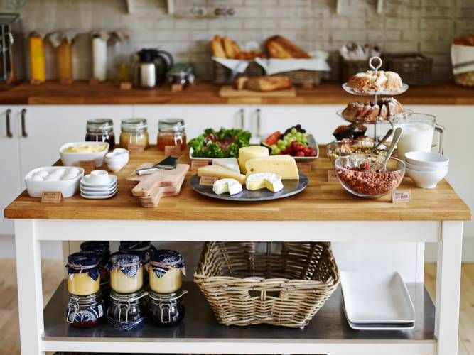 The STENSTORP kitchen island is the perfect space for serving appetizers for your holiday parties and storing everything you need nearby.