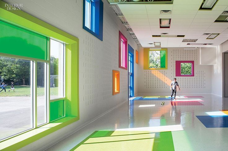 Taylor Smyth Architects added a multipurpose room to Toronto's West Preparatory Junior Public School for eating lunch, holding music classes, playing games, and hosting community meetings. Brightly painted plywood surrounds the windows, placed to frame the sky or the jungle gym from child height. Firm: Taylor Smyth Architects. Project: West Preparatory Junior Public School. Location: Toronto. Photography by Ben Rahn/A-Frame.