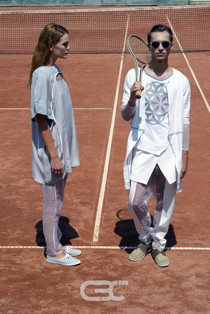 Lookbook:  Her: Grey dress, sheer pants. Him: White jacket, white tshirt, sheer pants, white skirt. Tennis court, sport, sportswear, fitness, trends, unisex, campaign photos. Order via facebook, pm or e-mail.