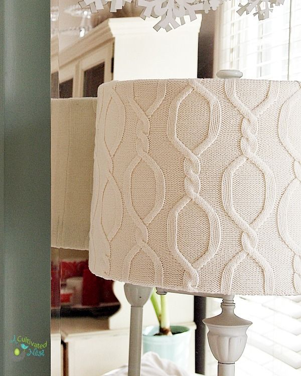 DIY Sweater Covered Lampshade at A Cultivated Nest. Transform an old sweater into a cute wintery lampshade. This is a great upcycle project!