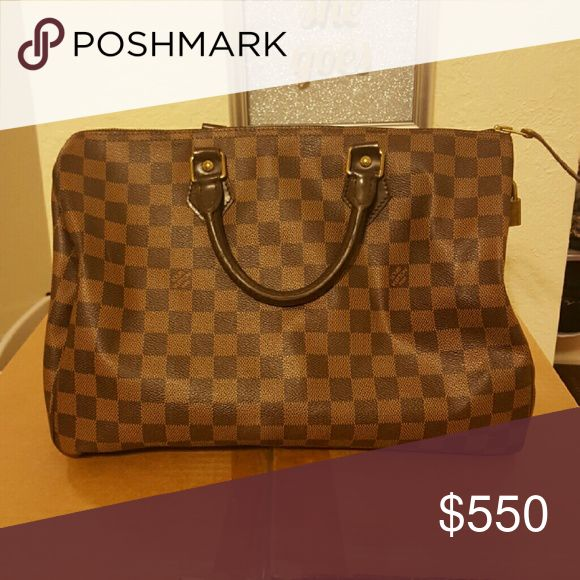 Louis Vuitton handbag Like new.  Inside has a few stains. Authentic Louis Vuitton Bags Totes