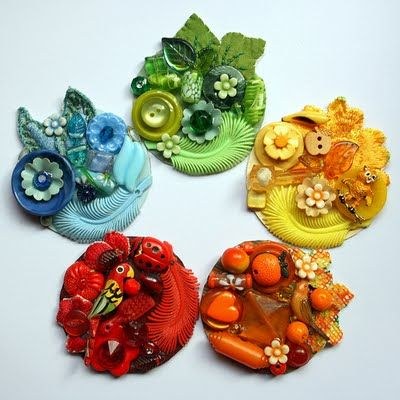button brooches, the blue and green kinda look like faces