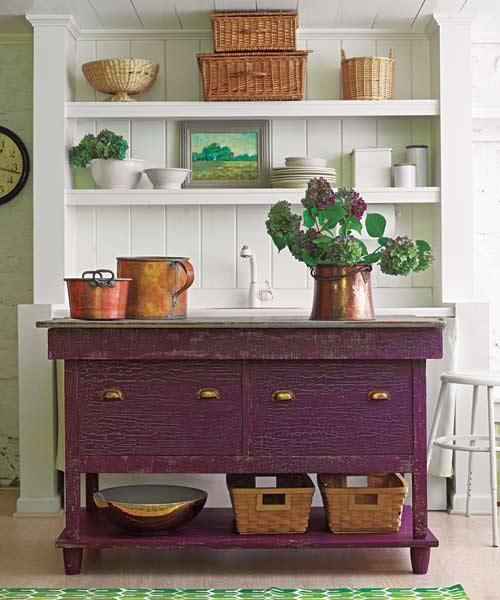 To mimic a vintage patina, this kitchen island was painted with a faux-aged finish using layered paint. Shown here: Sweet Pea (base coat) and Autumn Purple (top coat), Benjamin Moore.   Photo: Wendell T. Webber   thisoldhouse.com