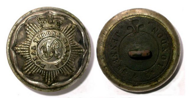 A two-piece tunic button (tin or silver front) of the ROYAL TYRONE MILITIA, dating from 1855-1881. The back is inscribed with the name of the maker JENNENS & CO LONDON. This maker operated from c1800-1924