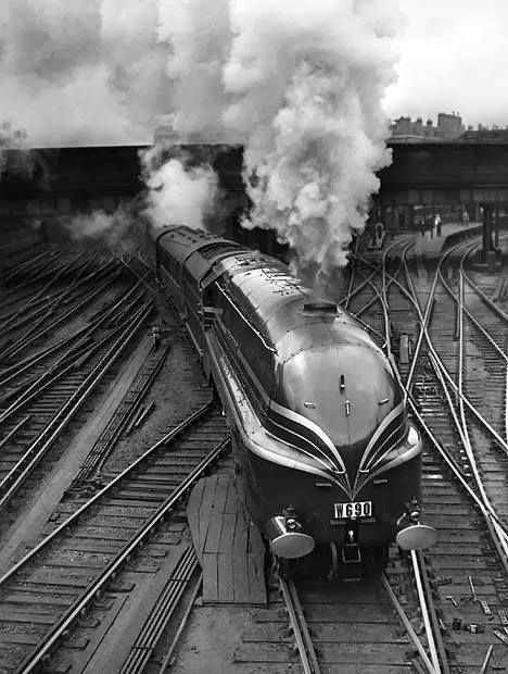 """8th June 1938 - The new LMS streamlined locomotive """"Duchess of Gloucester"""" leaves Euston Station in London on her first long distance journey. - Photo by H. F. Davis."""