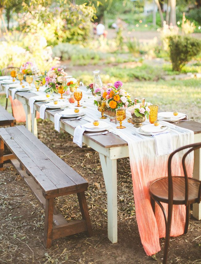 Beautiful ombre tablecloths and outdoor tables with colorful flowers. Love it.
