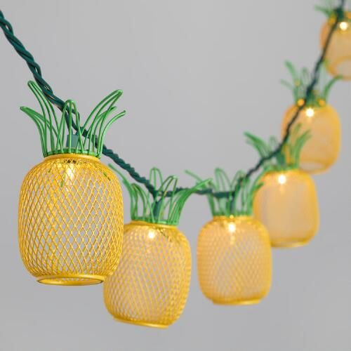 Featuring 10 yellow and green wire pineapples, our tropical string lights add a festive atmosphere indoors or out.