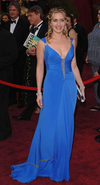 Kate Winslet Evening Dress - Kate Winslet looked glamorous in a blue Badgley Mischka gown at the 2005 Oscars. The dress featured a fitted bodice with beaded detail.