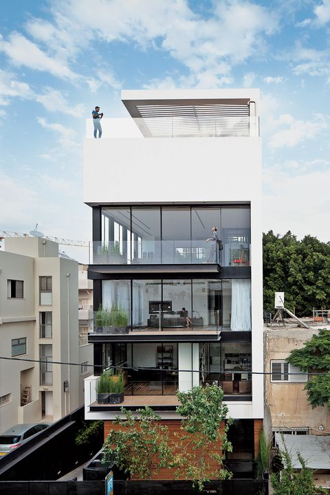 MODERN HIGH-RISE TOWN HOUSE IN TEL AVIV Six stories high, crowned with a pool, and with a direct lineage back to the Bauhaus, a new town house in Tel Aviv manages to both embrace and provide refuge from the teeming Israeli city.
