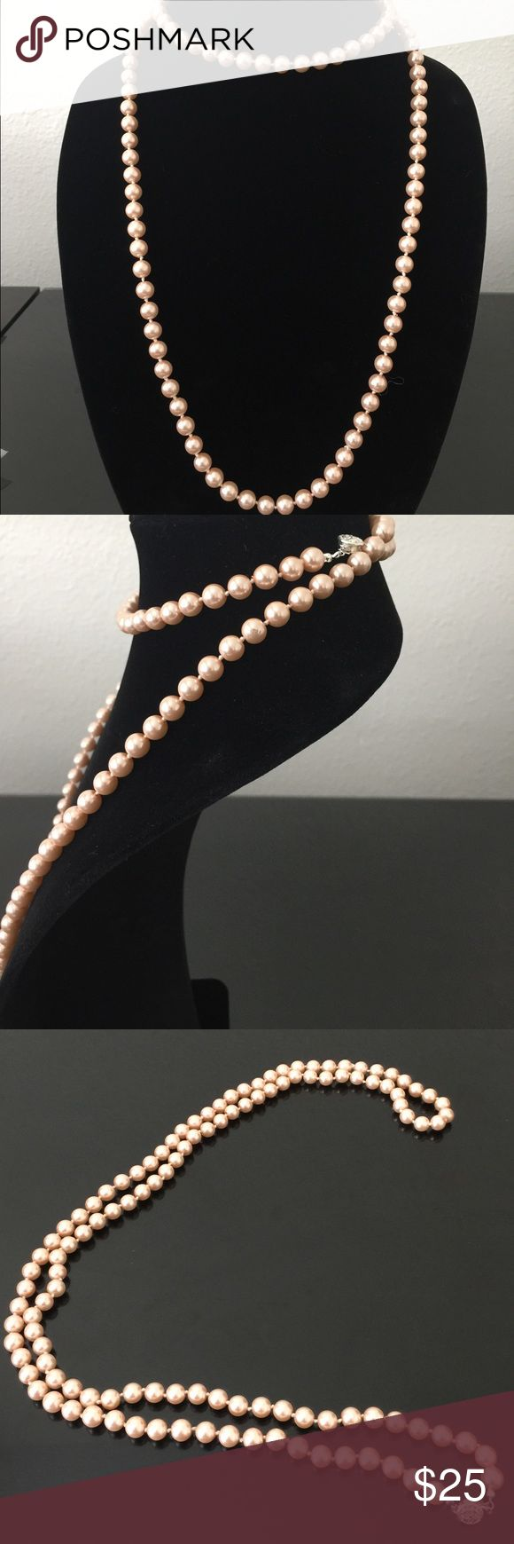 """A gorgeous gleaming strand of imitation necklace. A gorgeous gleaming strand of pink imitation pearl take you from workweek to the weekend without missing a beat, designed with silver tone mixed metal. Approx length 42"""". Charter Club Jewelry Necklaces"""