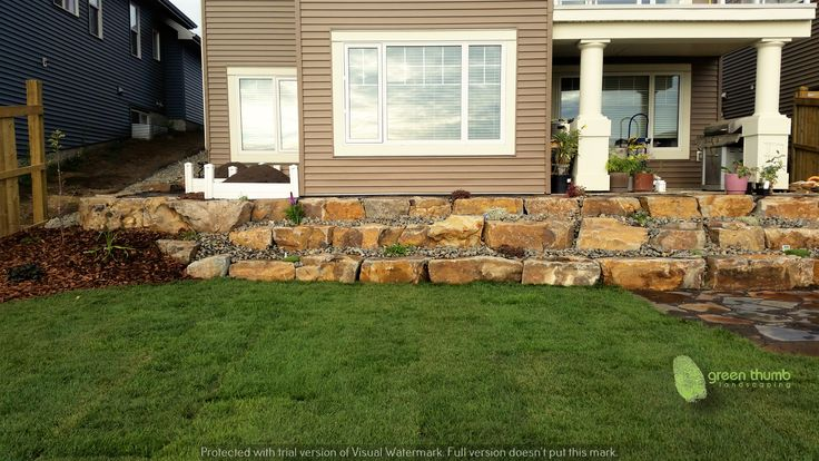 Natural stone is timeless. If you are considering installing a retaining wall, natural stone wall made from boulders and plants is a fantastic option. When the plants mature they will cascade this wall giving it a more modern/rustic feel.